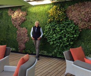 "Crystal Symphony ""Living Wall"" with map of continents"