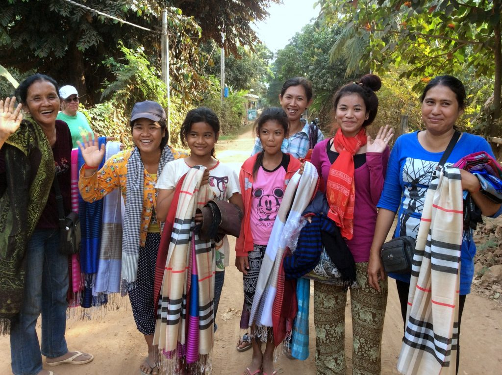Cambodian Women selling scarves along the road