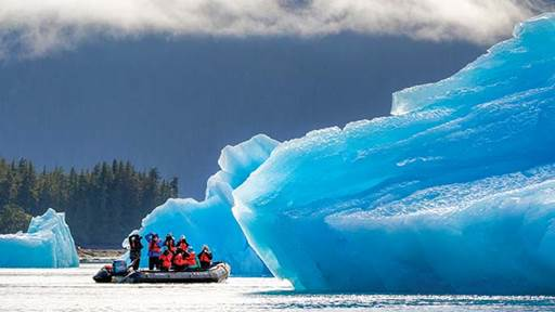 Lindblad guests zip around icebergs during a 5-night Alaska expedition.