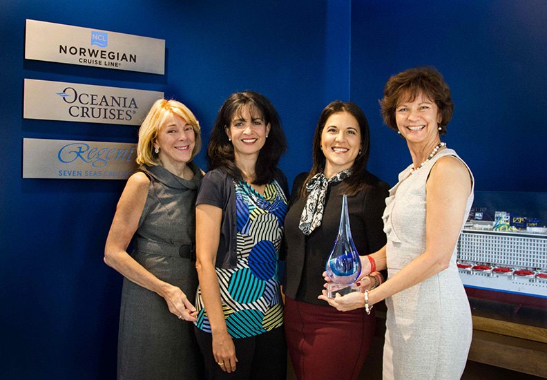 MICE Cruise Award:Landry & Kling's founders Jo Kling (left) and Joyce Landry (far right) presented a commemorative award to Norwegian Cruise Line Holdings' Katina Athanasiou, VP Charters, Meetings and Incentives; also shown, NCLH's Lisette Martinez, Director of Sales Operations and Services, Charters, Meetings & Incentives.