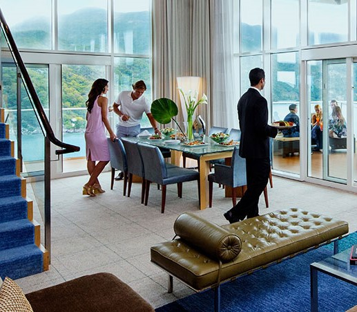 """Royal Genie"" Butler serves group in Royal Caribbean Royal Loft Suite"