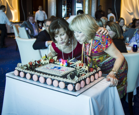 Joyce Landry & Jo Kling with a festive cake from Celebrity Cruises at their 35th Anniversary Event on Celebrity Reflection.