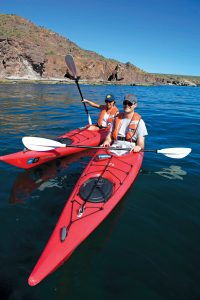 Short Baja Cruises with Lindblad -Guests kayaking in Baja California