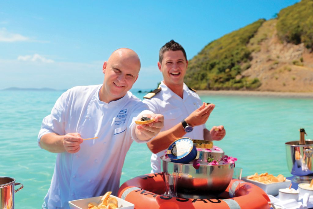 SeaDream Yacht charters include champagne and caviar served in the Caribbean surf