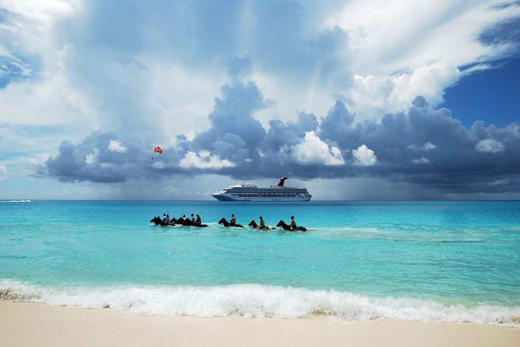 Horseback riding by land and sea available at Half Moon Caye