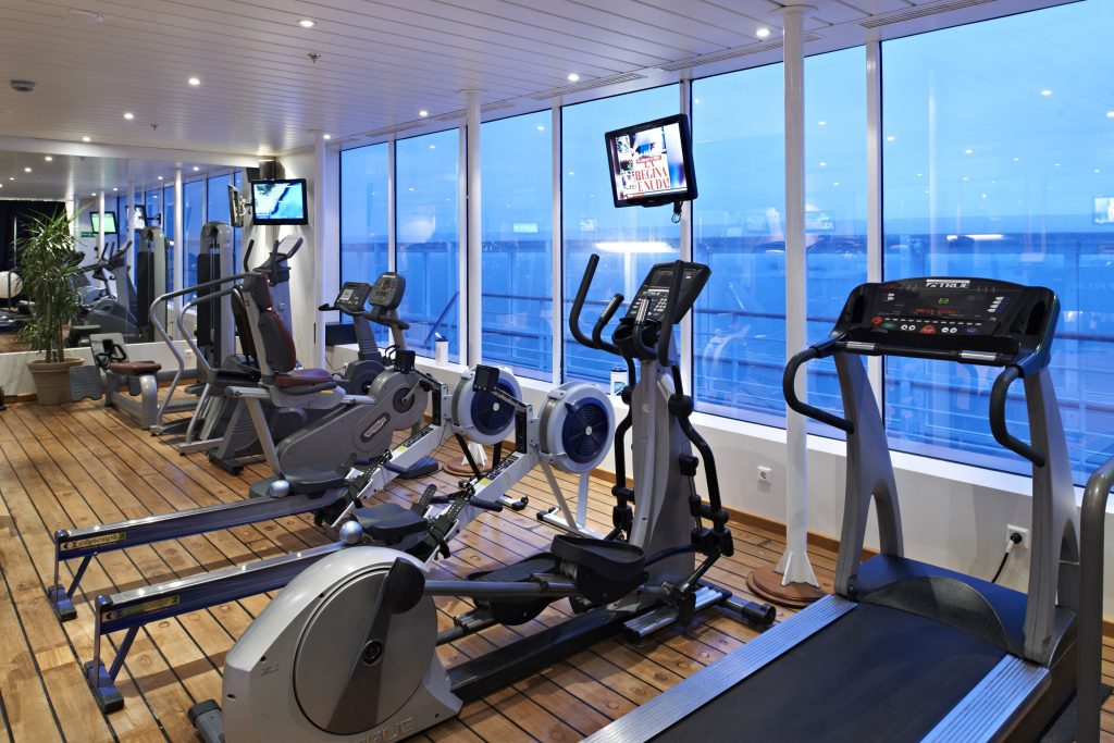 Full-service cruise ships used as floating accommodations include fitness centers